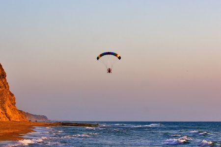Flight on an operated parachute along coast of Mediterranean sea Stock Photo - 1236315