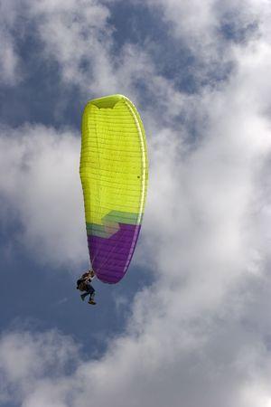 Flight on an operated parachute along coast of Mediterranean sea Stock Photo - 1355388