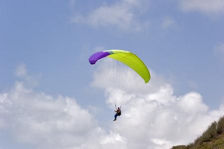 Flight on an operated parachute along coast of Mediterranean sea Stock Photo - 1397030