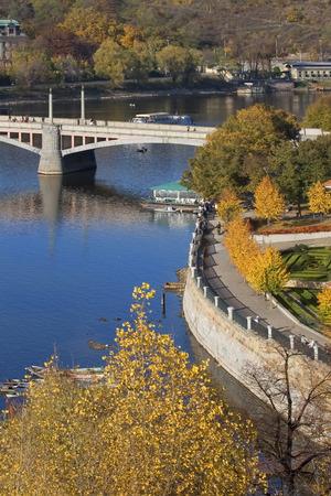 The bridge through the river Vltava in Prague photo