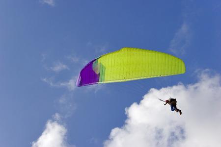 Flight on an operated parachute along coast of Mediterranean sea Stock Photo - 1490600