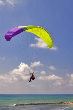 Flight on an operated parachute along coast of Mediterranean sea Stock Photo - 1613094