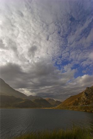 glen:  Mountain lake in the Swiss Alpes in cloudy autumn day