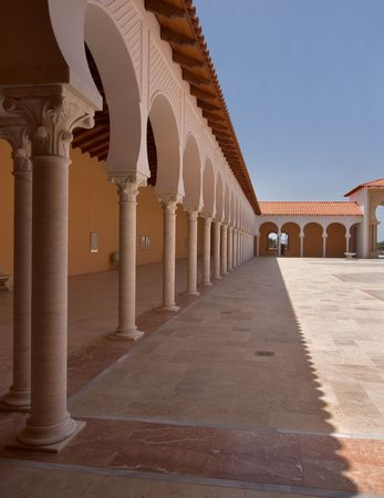 spanish style:  A court yard in the Spanish style, decorated by gallery and columns