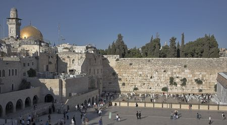 The Western wall of the Temple in Jerusalem shined by the sun photo