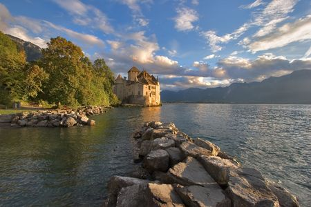A medieval fortress ?hillon on lake Leman on a sunset photo