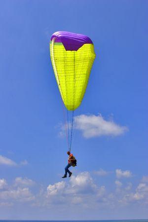 Flight on an operated parachute along coast of Mediterranean sea Stock Photo - 2136566