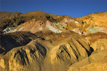 Beautifully painted hills in Death valley photo