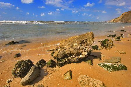 Coast of Mediterranean sea with big stones in water Stock Photo - 2320544
