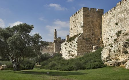 A green lawn and trees at a wall of Jerusalem near David's tower Stock Photo - 2320542