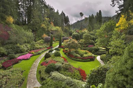 garden of eden: Phenomenally beautiful and picturesque garden for walks and supervision over flowers and trees Stock Photo
