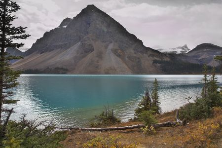 Mountain of the correct pyramidal form in northern Canada, reflected in lake Stock Photo - 2409132