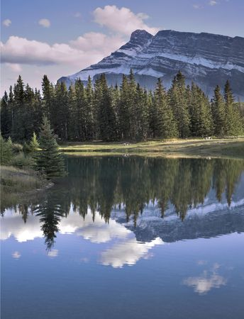 Small lake in the early cold morning in mountains of Canada Stock Photo - 2687296