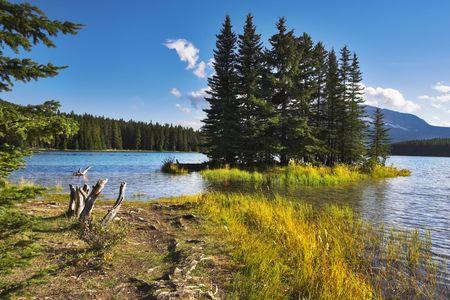 A footpath to coast of lake and small island near to coast. Stock Photo - 2739355