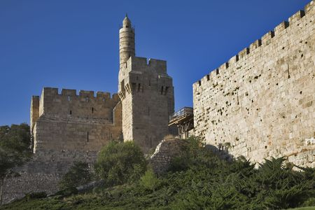 The ancient walls surrounding Old city in Jerusalem and the Tower of David  photo