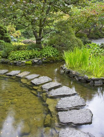 A path from the wet stones, laid through a pond in Japanese to a garden Stock Photo - 2824378