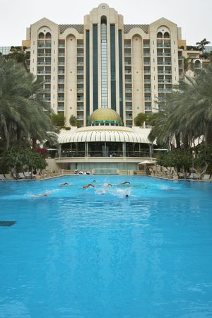 Group of fine sportsmen on training in pool of magnificent hotel a  photo