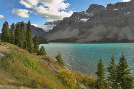 Northern lake surrounded by a wood and mountains in Canada