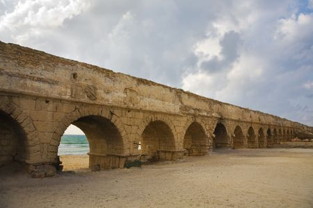aqueduct: Perfectly kept aqueduct of the Roman period at coast of Mediterranean sea in Israel Stock Photo