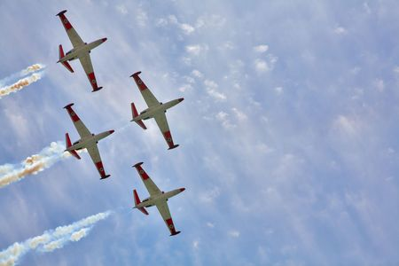 Synchronous flight of four sparkling planes on air celebratory parade photo