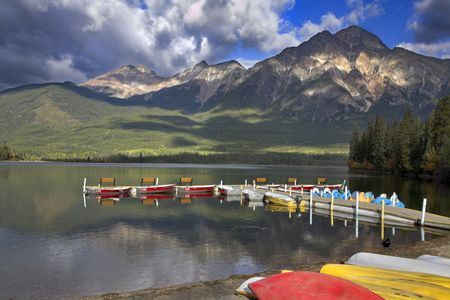 Lake, a boat mooring and boats on coast,