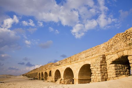 Perfectly kept aqueduct of the Roman period at coast of Mediterranean sea in Israel photo