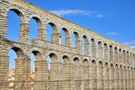 The well-known antique aqueduct and ancient Segovia in fine May day photo