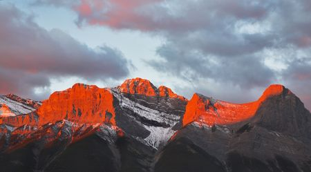 Tops of mountains sparkling by red morning color in northern Canada photo