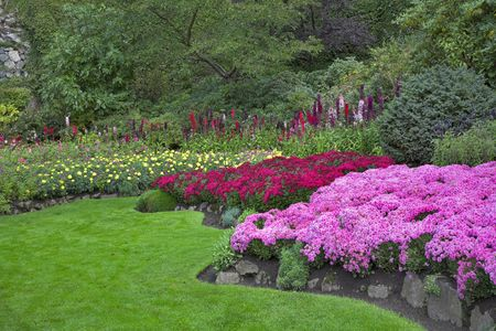 Phenomenally beautiful and picturesque garden for walks and supervision over flowers and trees Archivio Fotografico