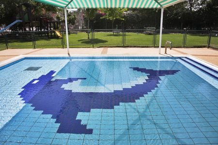 superficial: Superficial childrens pool under a canopy in summer day