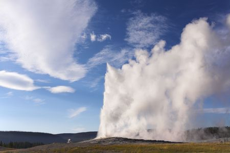 phenomena: The well-known geyser in Yellowstone national park - Old Faithful. Eruption comes to an end