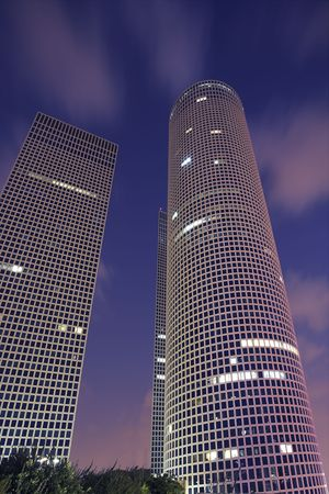 Magnificent high-altitude buildings in business part Tel-Aviv on a  of pink clouds photo