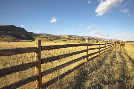 pasture fence: An easy cloud in pastoral midday on the American farm