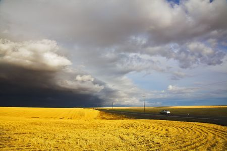 The car on highway among the fields, going aside thunder-storms Stock Photo - 3872584