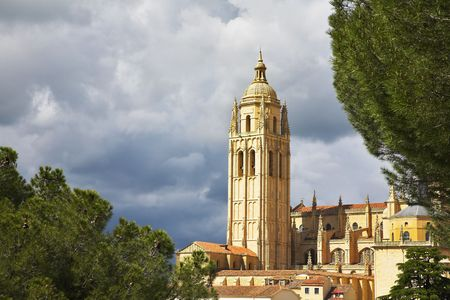 Tower of a cathedral in Segovia on a background of the cloudy sky Stock Photo - 3872608