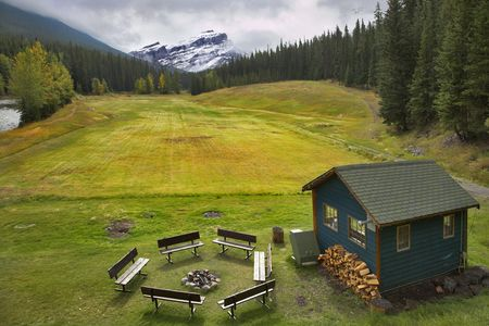 A field for a golf, a brazier, benches and a small house for rest in park photo