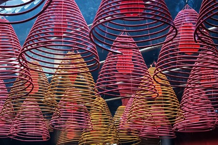 Cones � incense burners, hooked from a ceiling of a Chinese temple  photo