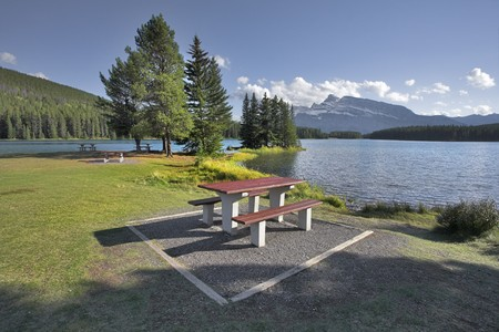 A cosy corner for picnic on coast of shallow lake in Canada photo