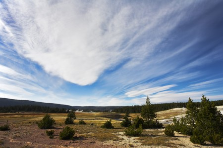 Flying clouds above meadows and woods of the most well-known park in the world Yellowstone national park photo