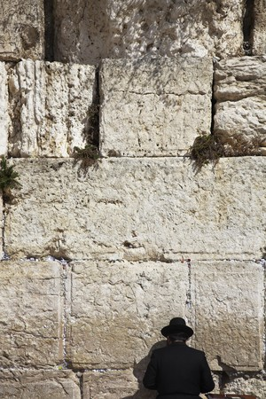 monotheism: The religious Jew praying at the Western wall of the Jerusalem temple Stock Photo
