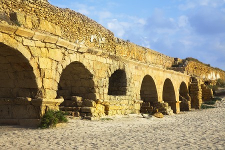 The aqueduct of the Roman period at coast of Mediterranean sea in Israel photo