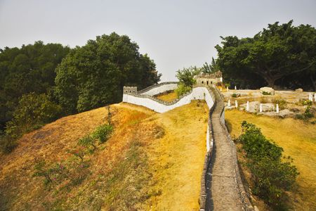 reduced: The reduced copy of the Great Chinese wall in the Chinese park of entertainments Stock Photo