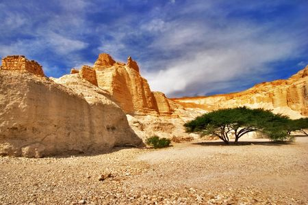 Ancient mountains near to an oasis Ein-Bokek at coast of the Dead Sea photo