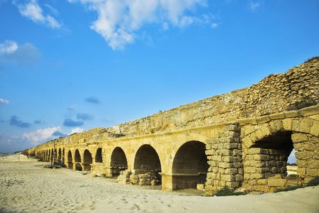 The aqueduct of the Roman period at coast of Mediterranean sea  photo