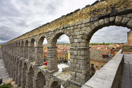 segovia: The well-known antique aqueduct and ancient Segovia in cloudy May day