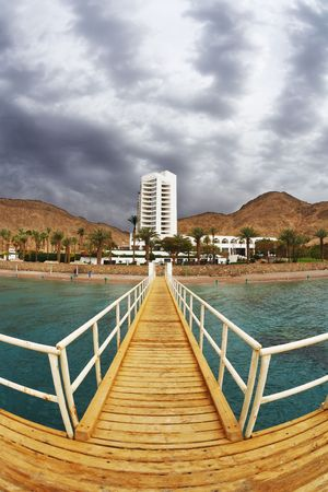The wooden pier on beach of Red sea in Eilat  photo