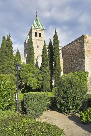 Fine park with beds and lawns at walls of ancient city Toledo in Spain photo