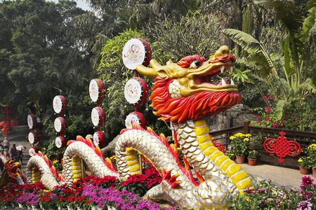 Traditionally decorated ladder in the Chinese park - a red dragon and bright flowers photo