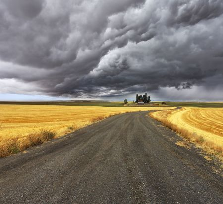 Thunder-storm above Montana. Fields after harvest and road photo