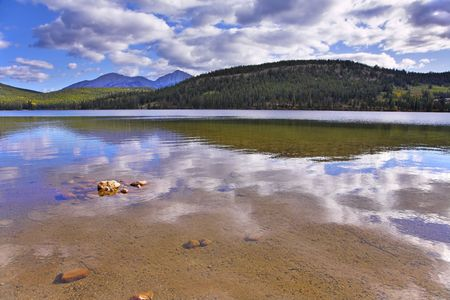 Shallow lake in rocky mountains of Canada photo